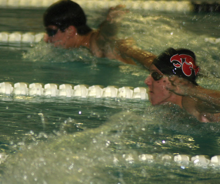 Ben Weideman takes a breath on his way to second place in the 100 fly finishing with a time of 55.8.