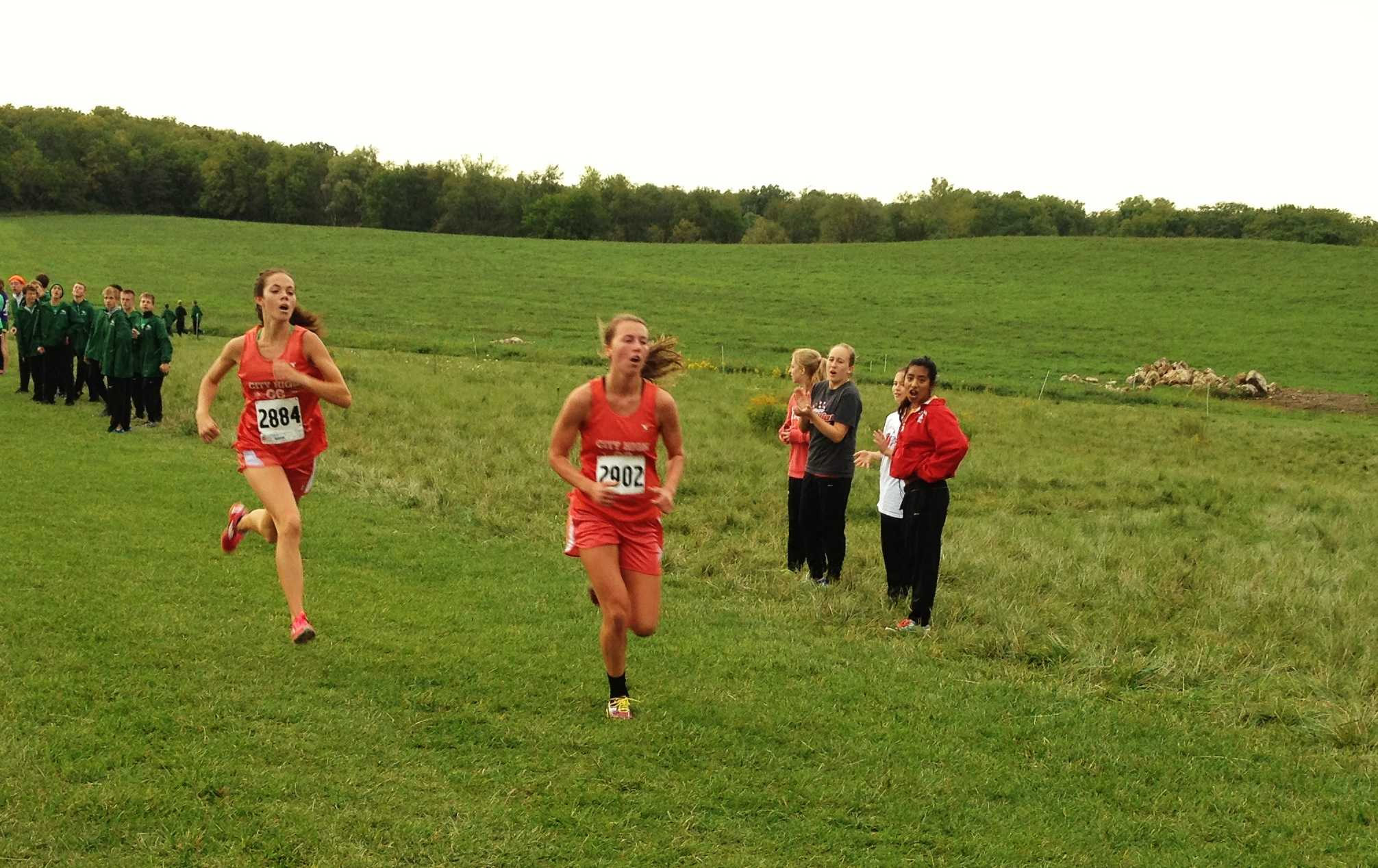Ellen Carman '14 and Lindsey Bruns '13 run in The Little Hawk Invite. Photo by Jon Rogers.