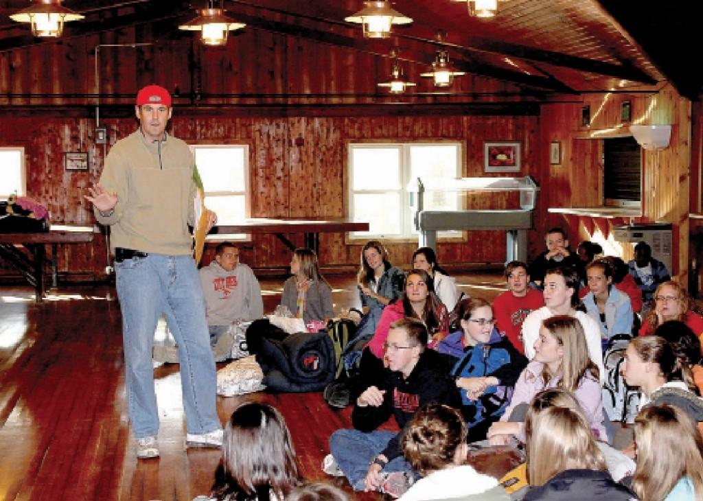 Principal John Bacon speaks to students in the YMCA Wapsie Lodge at the 2011 retreat.  Photo by Jason Arnold