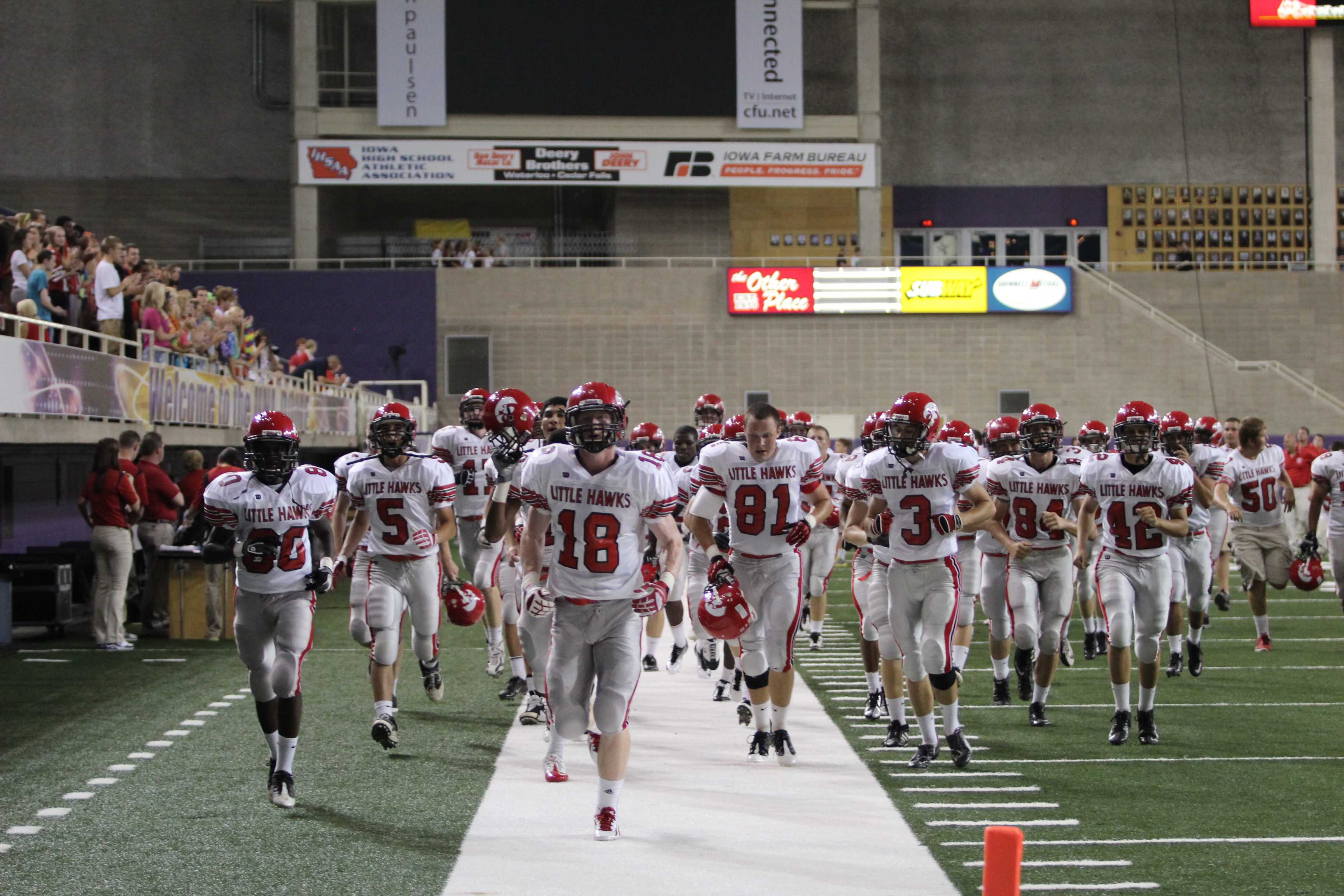 The Little Hawks jog off the field at the UNI Dome