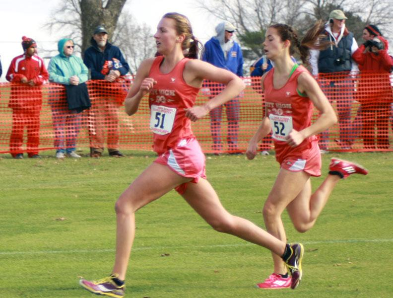 Lindsey Bruns '13 and Ellen Carman '14 run for the finish line at the state meet on Saturday.  Photo by Oli Peters