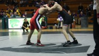 Alex Lemus 13' wrestles Skylar Laughlin 14' of Waterloo West. Lemus pinned Laughlin.
