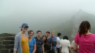 University of Iowa students climbing the Great Wall of China.
