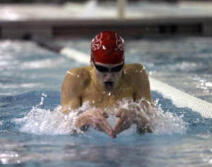 Harris Thompson '13 competes in the Breaststroke during a home meet at Mercer Aquatic Center. Photo by Kierra Zapf