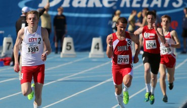 Brook Price '13 runs the final stretch of the 3200M run at the 2013 Drake Relays. Photo by Ryan Young.