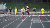 Sarah Plock '15 jumps a hurdle in the final leg of the 400 hurdles on Thursday.  Photo by Ryan Young