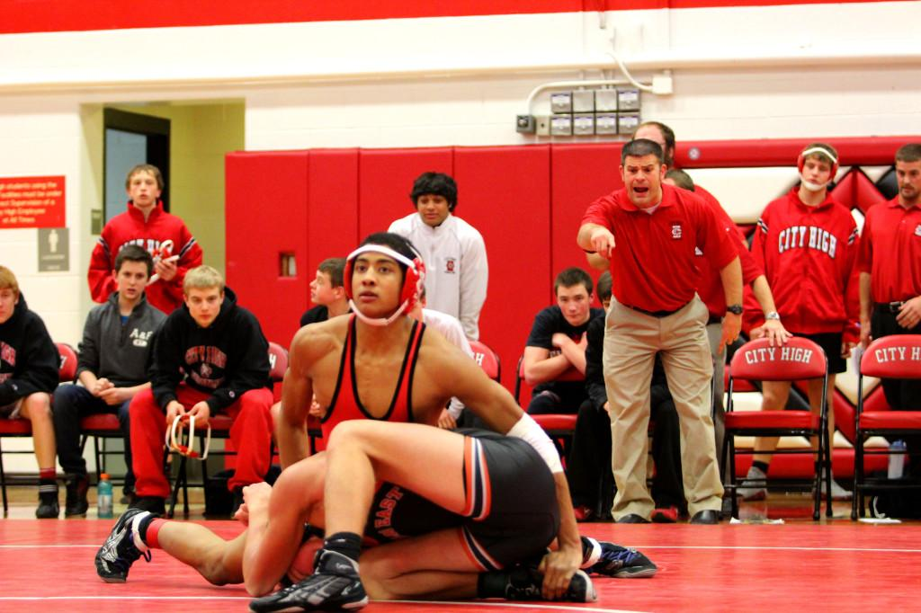 Ali Omar works his opponent in the home wrestling opener. Photo by Nathan Katalinich